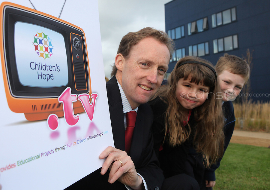 ***NO FEE PIC***.15/11/2010.Minister for Children Barry Andrews TD .Kim Mulvaney (8) from Sallynoggin.Paul Fitzpatrick (9) from Sallynoggin.at the launch of Children's Hope.TV at The Media Cube, IADT,Dun Laoghaire, Co. Dublin..The Irish children's Charity Children's Hope has developed an online educational resource for young people & youth workers, a website caleed www.childrens-hope.tv..The websitte features short curriculm-adhering educational programmes available to be played by young people in after-school projects geared to Youth & Comunity Leaders..Photo: Gareth Chaney Collins