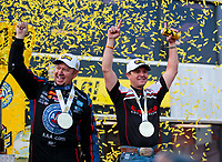 Nov 17, 2019; Pomona, CA, USA; NHRA funny car driver Robert Hight (left) and top fuel driver Steve Torrence celebrate after clinching the 2019 top fuel world championship during the Auto Club Finals at Auto Club Raceway at Pomona. Mandatory Credit: Mark J. Rebilas-USA TODAY Sports