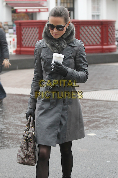 Pippa Middleton arrives for work,.London, England..December 21st, 2011.half 3/4 length grey gray mac jacket black tights bag purse fur scarf leather gloves sunglasses shades coffee drink beverage .CAP/HIL.©John Hillcoat/Capital Pictures.