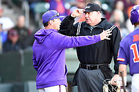 Head coach Monte Lee (13) of the Clemson Tigers speaks with home plate umpire Scott Kennedy in the Reedy River Rivalry game against the South Carolina Gamecocks on Saturday, March 3, 2018, at Fluor Field at the West End in Greenville, South Carolina. Clemson won, 5-1. (Tom Priddy/Four Seam Images)