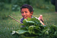 Young boy at play, Hadigau, Nepal.