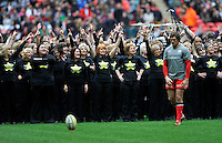 London, England. Alex Goode of Saracens backed by The Rock Choir  during the Saracens and Harlequins Aviva Premiership with a world record crowd of 83,761 for a club rugby match at Wembley Stadium. 31March 2012 at Wembley Stadium, London, England,