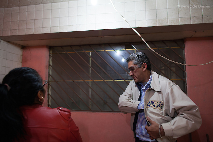 "Donovan and his assistant before carrying out a forensic cleaning in Iztacalco, Mexico on October 16, 2015. The decomposed body of a man in his 60s was found in his bedroom a number of days after he died of a heart attack – although the deceased's own family members were unsure exactly how long he had been there. The victim's family remarked that the police had made unfounded insinuations against them, and had sought bribes. As a result they found Donovan's discretion and professionalism to be a welcome contrast. Donovan Tavera, 43, is the director of ""Limpieza Forense México"", the country's first and so far the only government-accredited forensic cleaning company. Since 2000, Tavera, a self-taught forensic technician, and his family have offered services to clean up homicides, unattended death, suicides, the homes of compulsive hoarders and houses destroyed by fire or flooding. Despite rising violence that has left 70,000 people dead and 23,000 disappeared since 2006, Mexico has only one certified forensic cleaner. As a consequence, the biological hazards associated with crime scenes are going unchecked all around the country. Photo by Bénédicte Desrus"