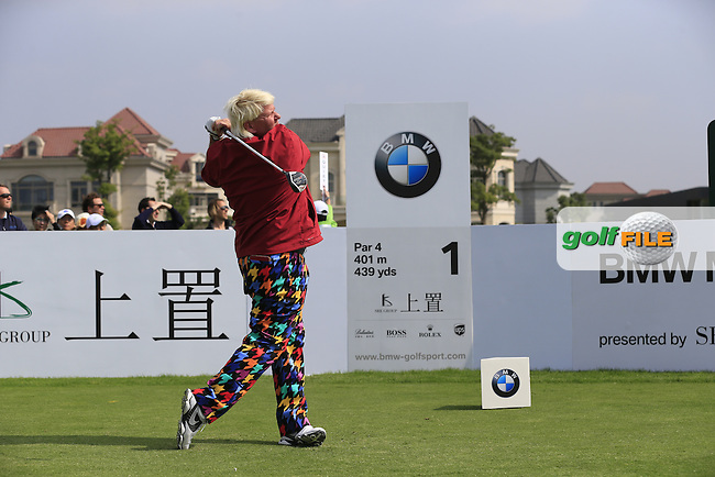 John Daly (USA) tees off the 1st tee to start his match during Saturday's Round 3 of the 2013 BMW Masters presented by SRE Group held at Lake Malaren Golf Club, Shanghai, China. 26th October 2013.<br /> Picture: Eoin Clarke/www.golffile.ie