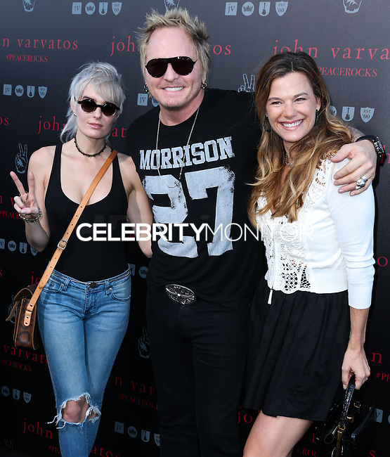 WEST HOLLYWOOD, CA, USA - SEPTEMBER 21: Ace Harper, Matt Sorum arrive at the John Varvatos #PeaceRocks Ringo Starr Private Concert held at the John Varvatos Boutique on September 21, 2014 in West Hollywood, California, United States. (Photo by Xavier Collin/Celebrity Monitor)