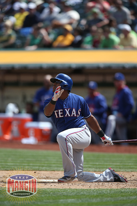 OAKLAND, CA - APRIL 9:  Adrian Beltre #29 of the Texas Rangers hits a home run from his knee against the Oakland Athletics during the game at O.co Coliseum on Thursday, April 9, 2015 in Oakland, California. Photo by Brad Mangin