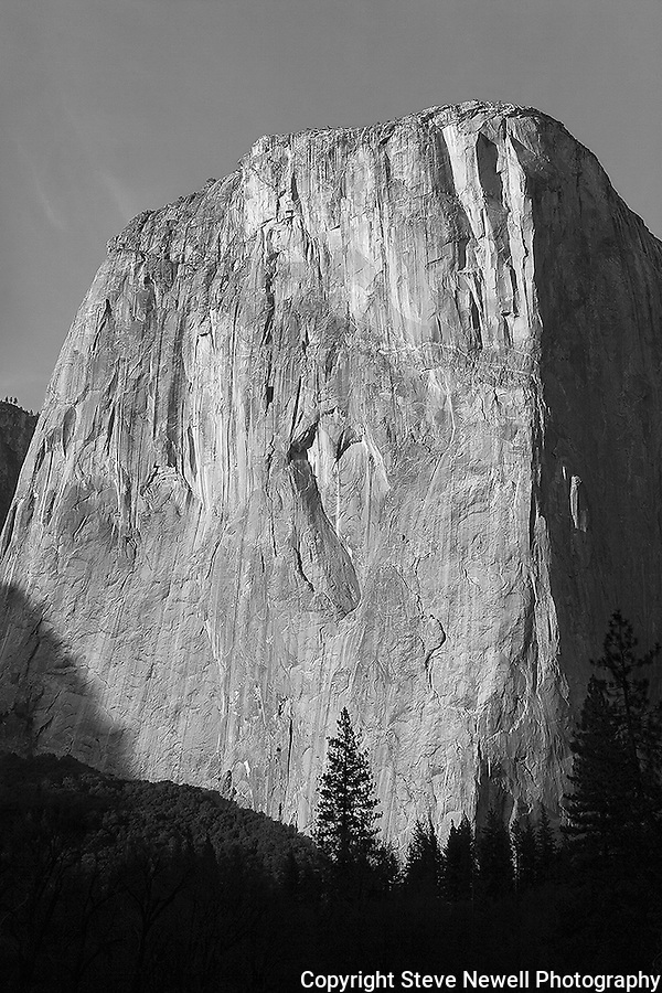 """The Capitan's Heart"" Black and White Artistic. El Capitan, Yosemite National Park. I made an adjustment smoothing out the texture of the rock giving it more of an artistic impression.  At certain times of the day the sunlight allows you to see the Heart shaped natural rock carving on El Capitan located in Yosemite National Park. This Incredible monolith changes colors drastically at sunsets. Rock climbers climb up the shear overhanging granite by the thousands every year. I have climbed all of the big walls in Yosemite including El Capitan four times.  Yosemite Valley is a very special place in the world and is a must visit destination for all."