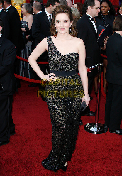 TINA FEY.The 82nd Annual Academy Awards held aat The Kodak Theatre in Hollywood, California, USA..March 7th, 2010.oscars full length one shoulder strap dress black clutch bag beaded patterned pattern sheer shoes slit split sequined sequin hand on hip.CAP/EAST.©Eastman/Capital Pictures.