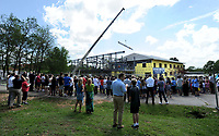 NWA Democrat-Gazette/ANDY SHUPE<br /> A large crowd of students, teachers, administrators and parents at The New School gather Wednesday, April 19, 2017, to watch as a large wooden beam is raised by a crane during a beam raising and tour of the school's expansion project in Fayetteville. The New School hopes to open the facility in the fall for the 2017-18 school year.