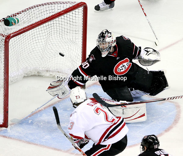 St. Cloud State goalie Mike Lee watches as a shot by UNO's Eric Olimb hits the back of the net during the second period. Olimb's goal put UNO up 1-0. UNO beat St. Cloud State 3-0 Friday night at Qwest Center Omaha.  (Photo by Michelle Bishop)