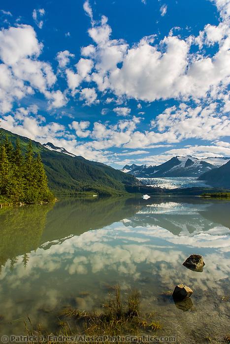 Mendenhall glacier flows out of the Coast mountains into Mendenhall lake near the southeast Alaska capital town of Juneau.