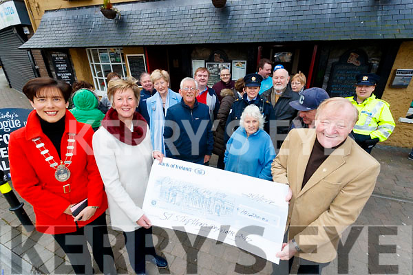 Michael Fox Connor presents Maura Sullivan a cheque for oner €10,000 which was raised from the Saint Stephens day walk at the Brogue inn, Tralee.