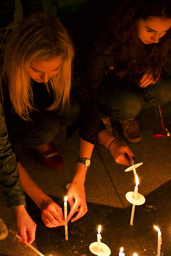 Demi Vitkute '17 set her candle down as part of the 9/11 Vigil put on by Emerson College.