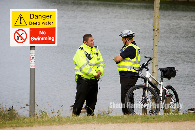 Pix: Shaun Flannery/shaunflanneryphotography.com...COPYRIGHT PICTURE>>SHAUN FLANNERY>01302-570814>>07778315553>>..19th July 2010.............Rotherham Metropolitan Borough Council (RMBC) - Water Safety..South Yorkshire Police officer Craig White and PCSO Paul Gray pictured at Manvers lake, Wath-upon-Dearne.