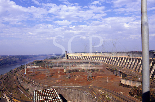 Itaipu Dam, Brazil. The dam with service roads and electricity pylons.