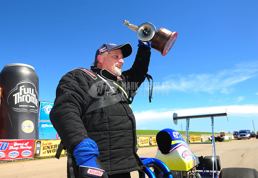 May 22, 2011; Topeka, KS, USA: NHRA top dragster driver Keith McCullar celebrates after winning the Summer Nationals at Heartland Park Topeka. Mandatory Credit: Mark J. Rebilas-