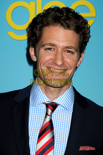 "MATTHEW MORRISON.Fox's ""Glee"" Spring Premiere Soiree held at Bar Marmont, West Hollywood, California, USA, .12th April 2010..portrait headshot  navy blue suit red tie shirt striped smiling gingham checked check .CAP/ADM/BP.©Byron Purvis/AdMedia/Capital Pictures."