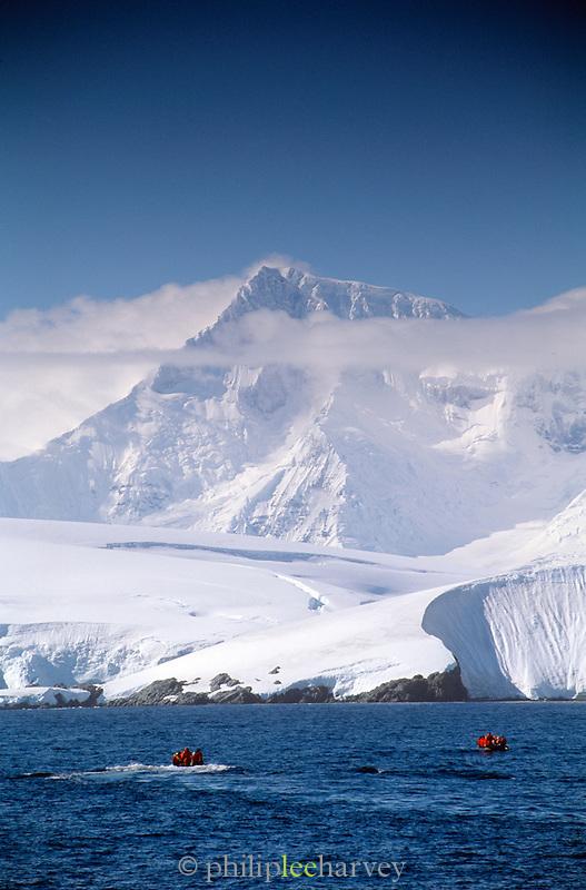 Antarctic Peninsula with Zodiac Inflatable crafts full of tourists, Antarctica