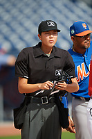 Home plate umpire Emma Charlesworth-Seiler goes over the ground rules during the lineup exchange before the first game of a doubleheader between the GCL Mets and GCL Nationals on July 22, 2017 at The Ballpark of the Palm Beaches in Palm Beach, Florida.  GCL Mets defeated the GCL Nationals 1-0 in a seven inning game that originally started on July 17th.  Mets manager Jose Carreno is to the right.  (Mike Janes/Four Seam Images)