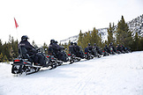 USA, Wyoming, Yellowstone National Park, snowmobilers take a break in Norris