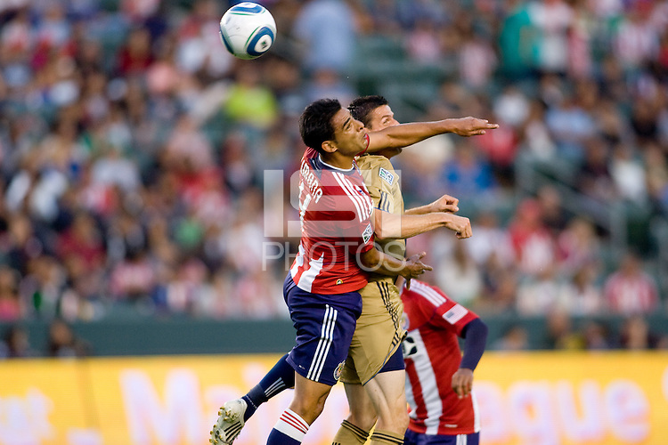 Philadelphia Union forward Sebastien Le Toux (9) battles with CD Chivas USA defender Michael Umana (4). The Philadelphia Union and CD Chivas USA played to 1-1 draw at Home Depot Center stadium in Carson, California on Saturday evening July 3, 2010..
