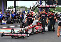 Apr 24, 2015; Baytown, TX, USA; Crew members with NHRA top fuel driver Steve Torrence during qualifying for the Spring Nationals at Royal Purple Raceway. Mandatory Credit: Mark J. Rebilas-