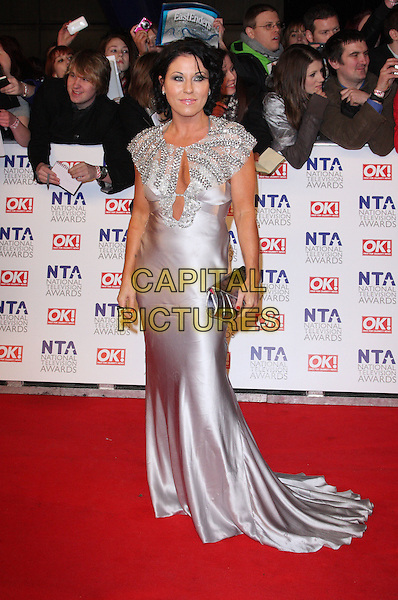 JESSIE WALLACE .National Television Awards at the O2 Arena, London, England..January 26th 2011.NTA NTAs full length maxi dress silver silk satin clutch bag cut out cleavage beads beaded.CAP/ROS.©Steve Ross/Capital Pictures