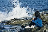 ON03-004z  Ocean - girl sitting on rocky beach watching waves break
