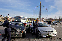 Traffic police investigate car accident between two BMW cars in Place de la Concorde, Central Paris, France