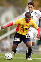 The Fire's Thiago is chased by Sergio Galvan Rey of the MetroStars.  The MetroStars defeated the Chicago Fire 2-0 during the inaugural Hall of Fame game on Monday October 11, 2004 at At-A-Glance Field at the National Soccer Hall of Fame and Museum, Oneonta, NY..
