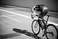 Michael Matthews (AUS/Orica-GreenEDGE) testing his legs on the finish straight of the Monza F1 Race Circuit and hitting 88km/h (coming from behind the team car)<br /> <br /> training/coffee ride with Team Orica-GreenEDGE at Monza (race circuit park) 1 day before Milan-San Remo
