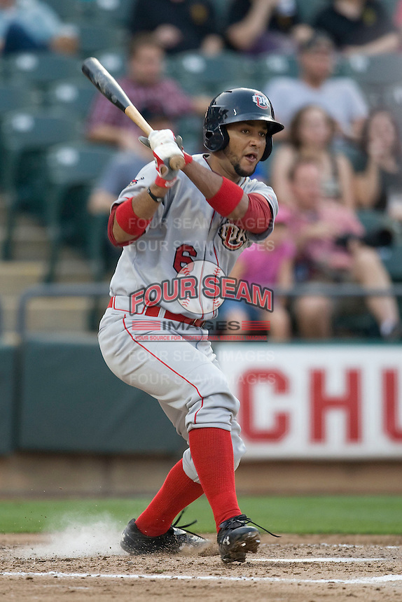Catcher Carlos Corporan #6 of the Oklahoma City RedHawks follows through against the Round Rock Express on April 26, 2011 at the Dell Diamond in Round Rock, Texas. (Photo by Andrew Woolley / Four Seam Images)