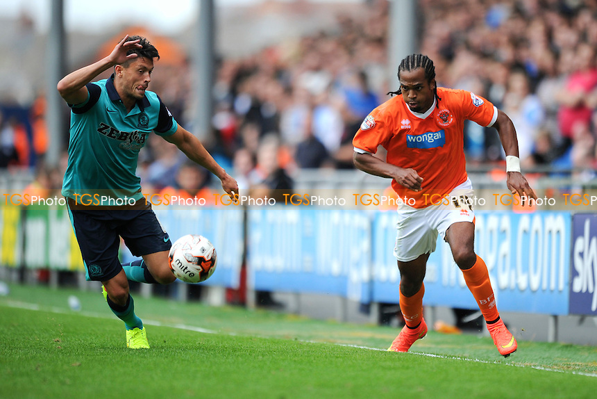 Nathan Delfouneso of Blackpool vies for the ball with Jason Lowe of Blackburn Rovers - Blackpool vs Blackburn Rovers - Sky Bet Championship Football at Bloomfield Road, Blackpool, Lancashire - 16/08/14 - MANDATORY CREDIT: Greig Bertram/TGSPHOTO - Self billing applies where appropriate - contact@tgsphoto.co.uk - NO UNPAID USE