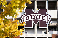 Fall gingko leaves with M State logo on the side of Davis Wade stadium.<br />  (photo by Beth Wynn / &copy; Mississippi State University)