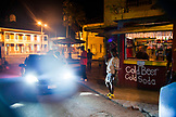 JAMAICA, Port Antonio. A street scene at night in the city center.
