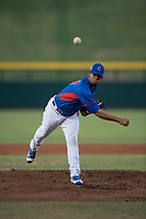 AZL Cubs relief pitcher Fernando Calderon (57) follows through on his delivery during an Arizona League game against the AZL Brewers at Sloan Park on June 29, 2018 in Mesa, Arizona. The AZL Cubs 1 defeated the AZL Brewers 7-1. (Zachary Lucy/Four Seam Images)
