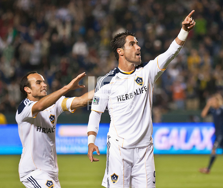 CARSON, CA – May 14, 2011: LA Galaxy midfielder Landon Donovan (10) helps celebrate forward Juan Pablo Angel's (9) goal during the match between LA Galaxy and Sporting Kansas City at the Home Depot Center in Carson, California. Final score LA Galaxy 4, Sporting Kansas City 1.