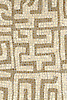 Kuba, a hand-chopped stone mosaic, is shown in tumbled Crema Marfil and Jura Grey.