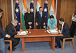 AUSTRALIA, Canberra : Indian Prime Minister Narendra Modi (CL) and Australian Prime Minister Tony Abbott (CR) watch as a memorandum of understanding between the Narcotics Control Bureau's is signed by the Indian Minister of External Affairs Anil Wadhwa (L) and the Australian Minister for Justice Michael Keenan (R) at Parliament House, Canberra on November 18, 2014. AFP PHOTO / MARK GRAHAM
