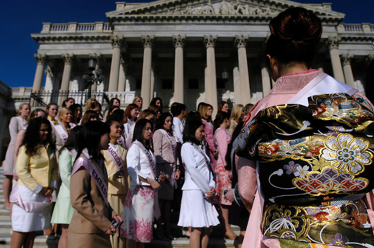 "Reina Mochizuki, the 2005 Japanese  ""Cherry Blossom"" Princess, waits to pose for a picture with other princesses on the East Front of the U.S. Capitol."