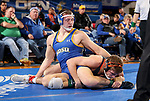 BROOKINGS, SD - NOVEMBER 17: Zach Carlson from South Dakota State University battles with Dakota Geer from Oklahoma State University during their 184 pound match Saturday night at Frost Arena in Brookings. (Photo by Dave Eggen/Inertia)