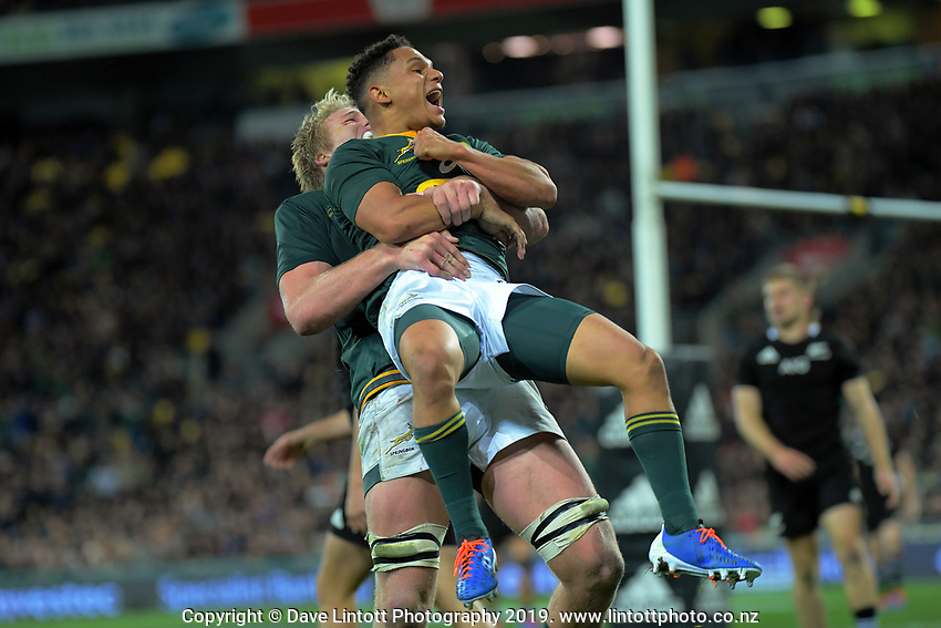 South Africa's Pieter-Steph du Toit congratulates South Africa's Herschel Jantjies on his last minute try during the Rugby Championship rugby union match between the New Zealand All Blacks and South Africa Springboks at Westpac Stadium in Wellington, New Zealand on Saturday, 27 July 2019. Photo: Dave Lintott / lintottphoto.co.nz
