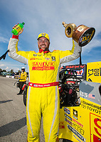 Sep 25, 2016; Madison, IL, USA; NHRA top fuel driver Shawn Langdon celebrates after winning the Midwest Nationals at Gateway Motorsports Park. Mandatory Credit: Mark J. Rebilas-USA TODAY Sports