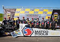 May 21, 2017; Topeka, KS, USA; NHRA top fuel driver Antron Brown celebrates with crew after winning the Heartland Nationals at Heartland Park Topeka. Mandatory Credit: Mark J. Rebilas-USA TODAY Sports