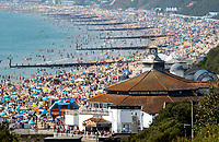BNPS.co.uk (01202 558833)<br /> Pic: PhilYeomans/BNPS<br /> <br /> The heat goes on...shimmering heat haze over roasting Bournemouth beach.<br /> <br /> Bournemouth beach was packed again today as the Bank Holiday heatwave continued.
