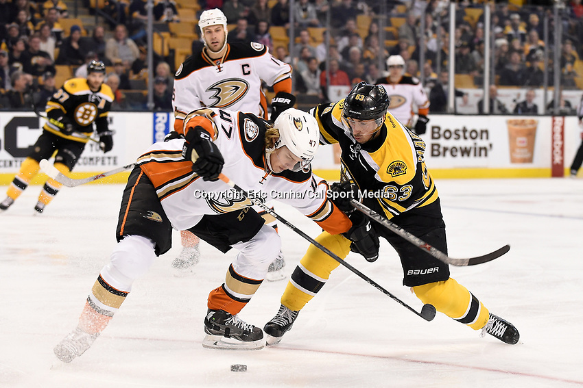 Tuesday, January 26, 2016:  Boston Bruins left wing Brad Marchand (63) and Anaheim Ducks defenseman Hampus Lindholm (47) battle for the puck during the National Hockey League game between the Anaheim Ducks and the Boston Bruins, held at TD Garden, in Boston, Massachusetts. Eric Canha/CSM