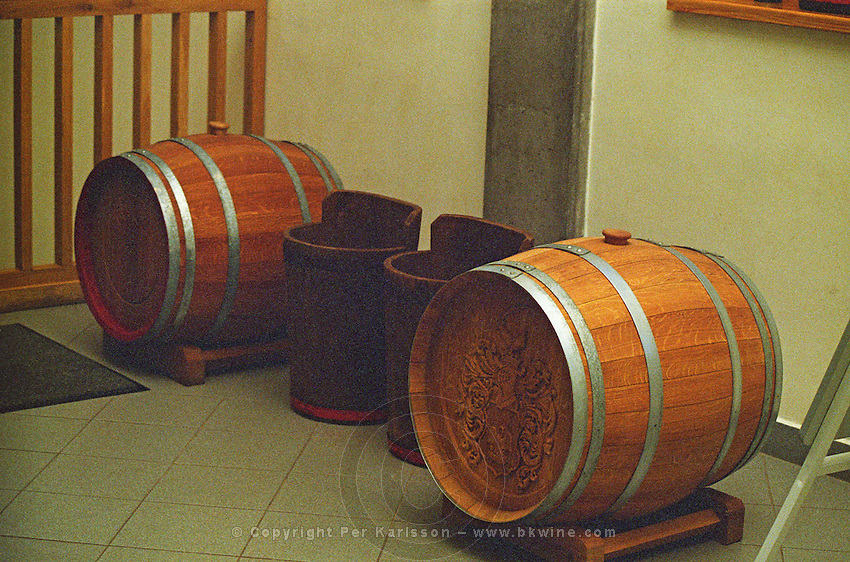 """At the Oremus winery, Tolcsva, Tokaj: Two """"puttonyos"""" baskets and two gönci casks. Traditionally the number of puttonyos on a bottle signifies how many baskets have been added to one cask. Today this is no longer so. Now it is a question of must weight. Oremus is owned by the Alvarez family that also owns Vega Sicilia in Spain It is managed by Andras Bacso. Credit Per Karlsson BKWine.com"""