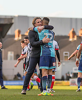 Wycombe Wanderers Manager Gareth Ainsworth embraces winning goal scorer Paris Cowan-Hall of Wycombe Wanderers during the Sky Bet League 2 match between Grimsby Town and Wycombe Wanderers at Blundell Park, Cleethorpes, England on 4 March 2017. Photo by Andy Rowland / PRiME Media Images.