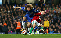 Wednesday 09 January 2013<br /> Pictured: (L-R) David Luiz and Leon Britton.<br /> Re: Capital One Cup semifinal, Chelsea FC v Swansea City FC at the Stamford Bridge Stadium, London.