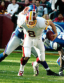 Landover, MD - December 24, 2005 --  Washington Redskin quarterback Mark Brunell (8) eludes New York Giant defenders Osi Umenyiora (72) and Gibril Wilson (28) in early game action at FedEx Field in Landover, MD on December 24, 2005.  The Redskins won the game 35 - 20..Credit: Ron Sachs / CNP.(RESTRICTION: NO New York or New Jersey Newspapers or newspapers within a 75 mile radius of New York City)